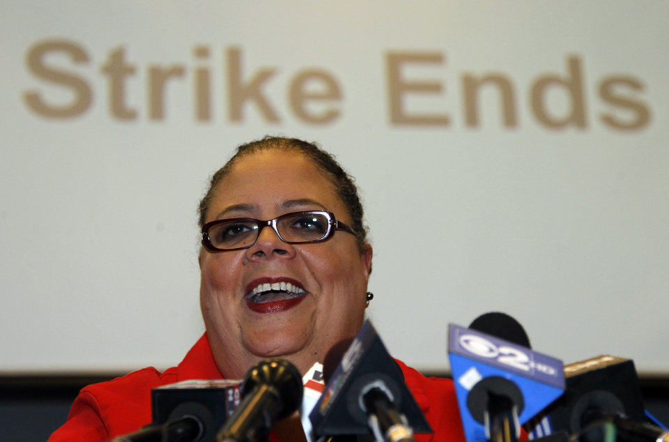 Photo -   Karen Lewis, president of the Chicago Teachers Union smiles as she talks with reporters after the union's House of Delegates voted to suspend the strike Tuesday, Sept. 18, 2012, in Chicago. (AP Photo/Charles Rex Arbogast)