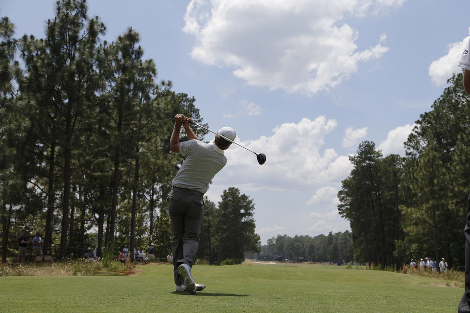 Photo - Lucas Glover watches his tee shot on the fifth hole during a practice round for the U.S. Open golf tournament in Pinehurst, N.C., Wednesday, June 11, 2014. The tournament starts Thursday. (AP Photo/Chuck Burton)