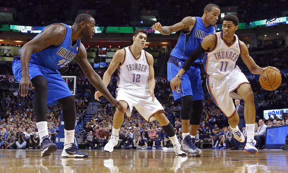 Oklahoma City's Jeremy Lamb (11) drives against Dallas' Monta Ellis (11) during the NBA basketball game between the Oklahoma City Thunder and the Dallas Mavericks at Chesapeake Energy Arena in Oklahoma City, Okla. on Wednesday, Nov. 6, 2013.  Photo by Chris Landsberger, The Oklahoman