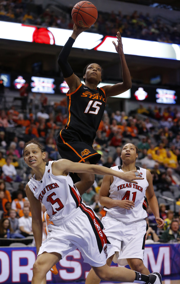 Oklahoma State's Toni Young (15) shoots a basket over Texas Tech's Casey Morris (15) and Kelsi Baker (41) during the Big 12 tournament women's college basketball game between Oklahoma State University and Texas Tech University at American Airlines Arena in Dallas, Saturday, March 9, 2012. Oklahoma State won 59-54.  Photo by Bryan Terry, The Oklahoman