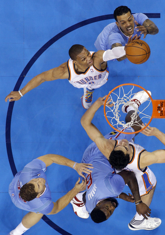 Photo - Oklahoma City 's Russell Westbrook (0) fights for a rebound with Los Angeles' Matt Barnes (22) during the NBA game between the Oklahoma City Thunder and the Los  Angeles Clippers at the Chesapeake Energy Arena, Sunday, Feb. 23, 2014. Photo by Sarah Phipps, The Oklahoman
