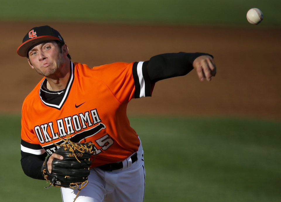 Photo - OSU's Garrett Williams pitches during a Bedlam baseball game between Oklahoma State University and the University of Oklahoma in Stillwater, Tuesday, April 15, 2014. Photo by Bryan Terry, The Oklahoman
