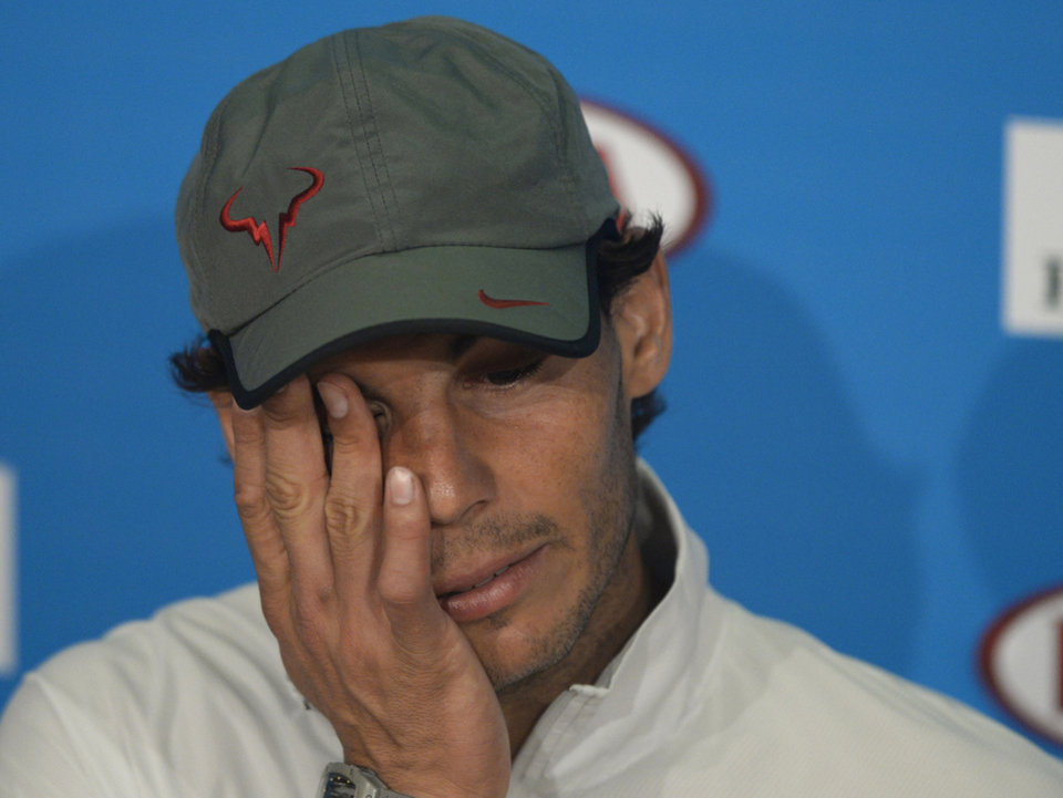 Photo - Rafael Nadal of Spain speaks during a press conference after his loss to Stanislas Wawrinka of Switzerland in the men's singles final at the Australian Open tennis championship in Melbourne, Australia, Sunday, Jan. 26, 2014. (AP Photo/Andrew Brownbill)
