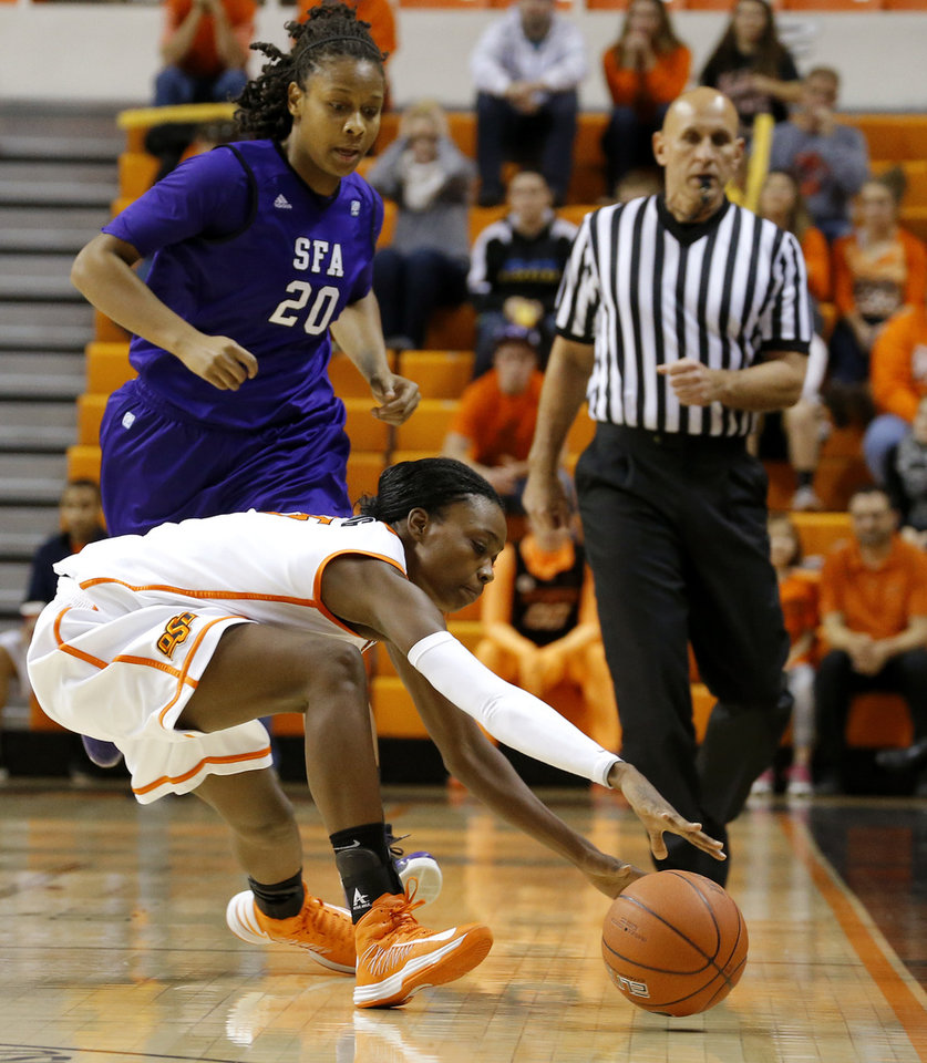 Photo - Oklahoma State's Toni Young (15) tries to gain control of the ball in front of Stephen F. Austin's Antionette Carter (20) during a women's college basketball game between Oklahoma State University and Stephen F. Austin at Gallagher-Iba Arena in Stillwater, Okla., Thursday, Dec. 6, 2012.  Photo by Bryan Terry, The Oklahoman