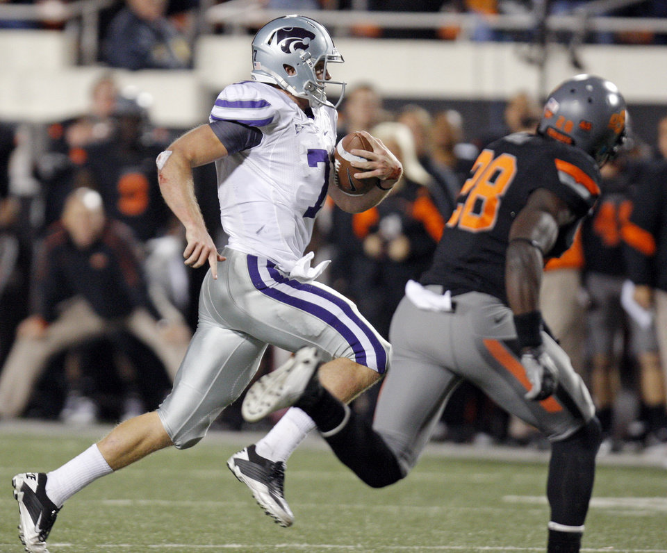 Photo - KSU's Collin Klein (7) scrambles for a first down after a fourth down in the fourth quarter during a college football game between the Oklahoma State University Cowboys (OSU) and the Kansas State University Wildcats (KSU) at Boone Pickens Stadium in Stillwater, Okla., Saturday, Nov. 5, 2011. OSU won, 52-45. Photo by Nate Billings, The Oklahoman