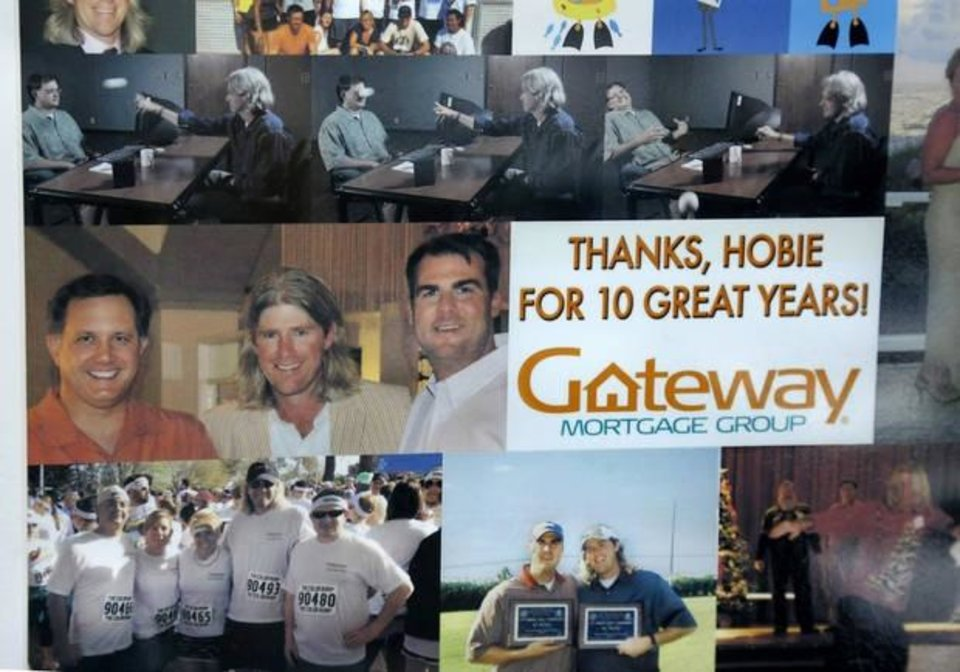 Photo -  This framed personalized poster was presented to Hobie Higgins to show the company's appreciation to him on the 10th  anniversary of service with Gateway First. Higgins is the company's chief engagement officer and went to college with Gov. Kevin Stitt, the founder and former CEO of Gateway. Photo taken Monday, July 15, 2019.   [Jim Beckel/The Oklahoman]