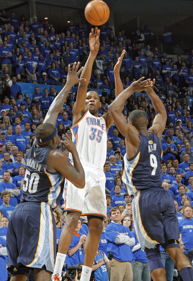 Photo - Oklahoma City's Kevin Durant (35) puts up a shot over Memphis' Zach Randolph (35) and Tony Allen (9) during game one of the Western Conference semifinals between the Memphis Grizzlies and the Oklahoma City Thunder in the NBA basketball playoffs at Oklahoma City Arena in Oklahoma City, Sunday, May 1, 2011. Photo by Chris Landsberger, The Oklahoman