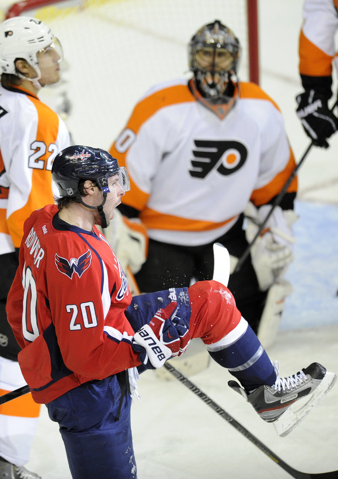 Washington Capitals right wing Troy Brouwer (20) celebrates his goal as Philadelphia Flyers goalie Ilya Bryzgalov (30), of Russia, and Luke Schenn (22) look on during the third period of an NHL hockey game on Friday, Feb. 1, 2013, in Washington. The Capitals won 3-2. (AP Photo/Nick Wass)