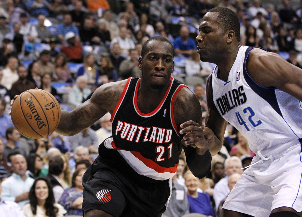 Portland Trail Blazers' J.J. Hickson (21) looks for an opening against Dallas Mavericks' Elton Brand (42) in the first half of an NBA basketball game, Monday, Nov. 5, 2012, in Dallas. (AP Photo/Tony Gutierrez)