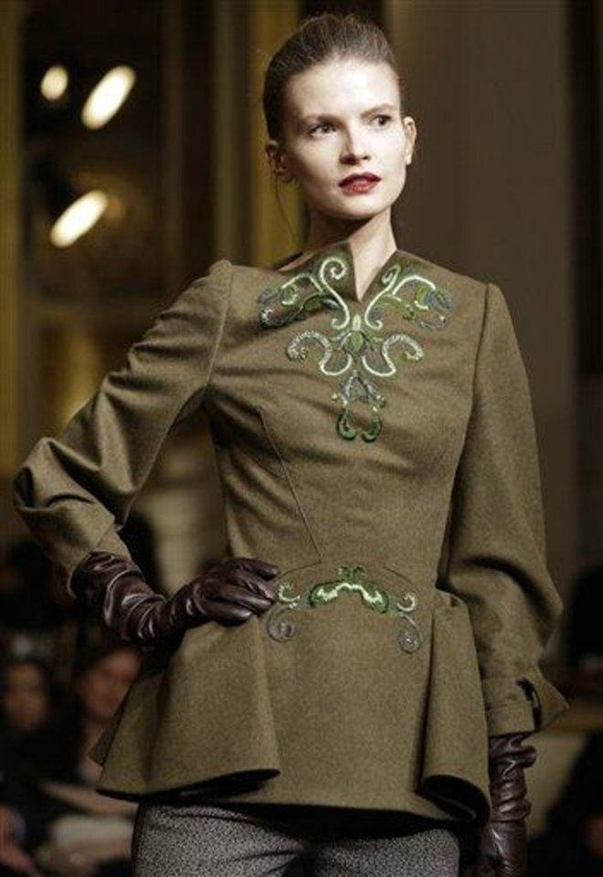 Photo - A model walks the runway during the Zac Posen Fall 2013 show at Fashion Week at the Plaza in New York, Sunday, Feb. 10, 2013.  (AP Photo/Kathy Willens)