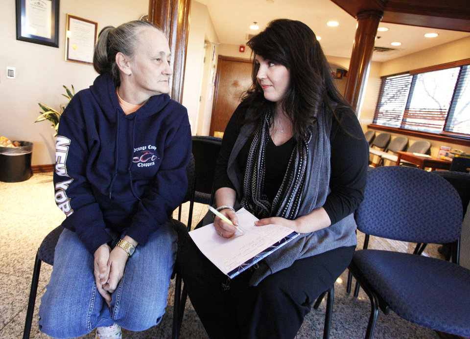 Ramona Ollerdisse, of Edmond, talks about her son Brandon with LaCinda Daugherty, the Wraparound project director at NorthCare. Ollerdisse's son Brandon is in a Wraparound program at NorthCare for teens and young adults. <strong>PAUL B. SOUTHERLAND - PAUL B. SOUTHERLAND</strong>