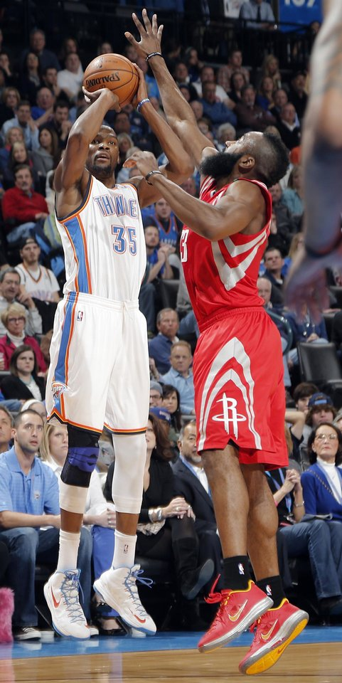 Oklahoma City 's Kevin Durant (35) shoots over Houston's James Harden (13) during the NBA basketball game between the Houston Rockets and the Oklahoma City Thunder at the Chesapeake Energy Arena on Wednesday, Nov. 28, 2012, in Oklahoma City, Okla.   Photo by Chris Landsberger, The Oklahoman