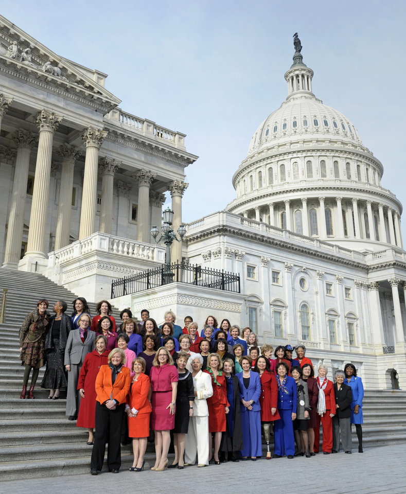 Photo - House Minority Leader Nancy Pelosi of Calif., front row, center, poses with female House members on the steps of the House on Capitol Hill in Washington, Thursday, Jan. 3, 2013, prior to the officially opening of the 113th Congress. (AP Photo/Cliff Owen)