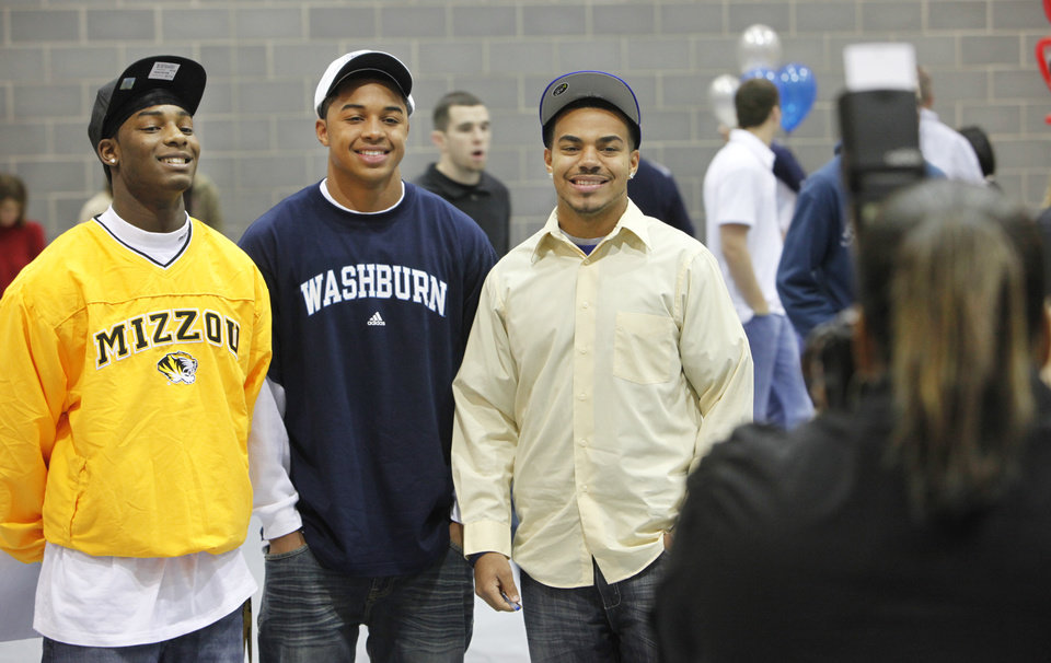 Football players Xavier Smith, Missouri;Brandon Downing, Washburn; and Ricky Lawyer, Northeastern, pose for a photo during Signing Day at Edmond North High School, Feb. 3, 2010. Photo by David McDaniel, The Oklahoman