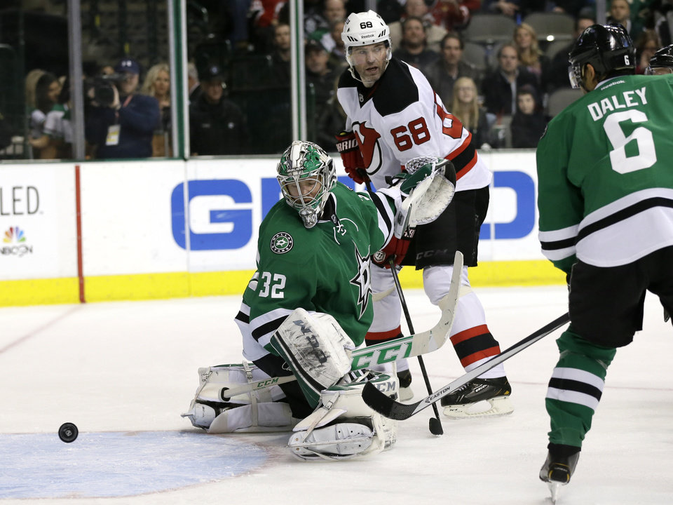 Photo - Dallas Stars' Kari Lehtonen (32) of Finland, Stars' Trevor Daley (6) and New Jersey Devils' Jaromir Jagr (68), of the Czech Republic, watch as a shot by Devils' Travis Zajac gets by Lehtonen for a goal in the second period of an NHL hockey game on Thursday, Jan. 30, 2014, in Dallas. (AP Photo/Tony Gutierrez)