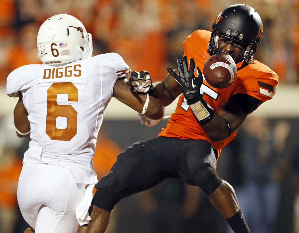 Photo - OSU's John Goodlett (15) has the ball knocked away by UT's Quandre Diggs (6) after crossing the goal line during a college football game between Oklahoma State University (OSU) and the University of Texas (UT) at Boone Pickens Stadium in Stillwater, Okla., Saturday, Sept. 29, 2012. Texas won, 41-36. The pass was originally ruled incomplete but was changed to a touchdown after a review. Photo by Nate Billings, The Oklahoman