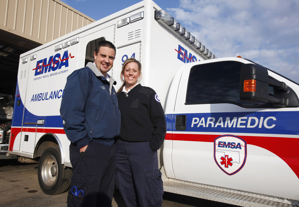 Husband and wife EMSA employees Tyler and Angi Whitmire outside their ambulance, unit 94, in Oklahoma City Thursday, Dec. 22, 2011.  Photo by Paul B. Southerland, The Oklahoman