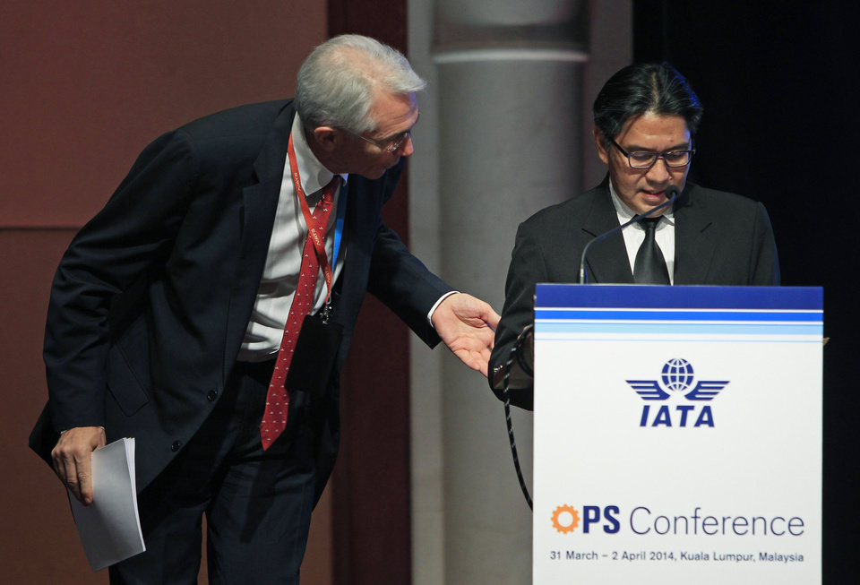 Photo - Chief Executive and Director General of the International Air Transport Association (IATA) Tony Tyler, left, talks to Malaysia's Department of Civil Aviation Director General Azharuddin Abdul Rahman after Azharuddin stopped his speech halfway and requested journalists to leave the conference room during the IATA Ops Conference in Kuala Lumpur, Malaysia, Tuesday, April 1, 2014. (AP Photo/Lai Seng Sin)