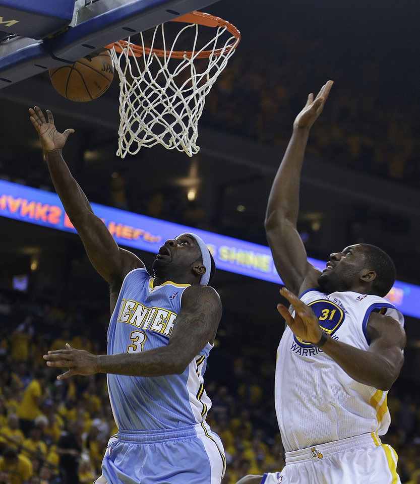 Denver Nuggets' Ty Lawson, left, lays up a shot against Golden State Warriors' Festus Ezeli (31) during the first half of Game 3 in a first-round NBA basketball playoff series on Friday, April 26, 2013, in Oakland, Calif. (AP Photo/Ben Margot)
