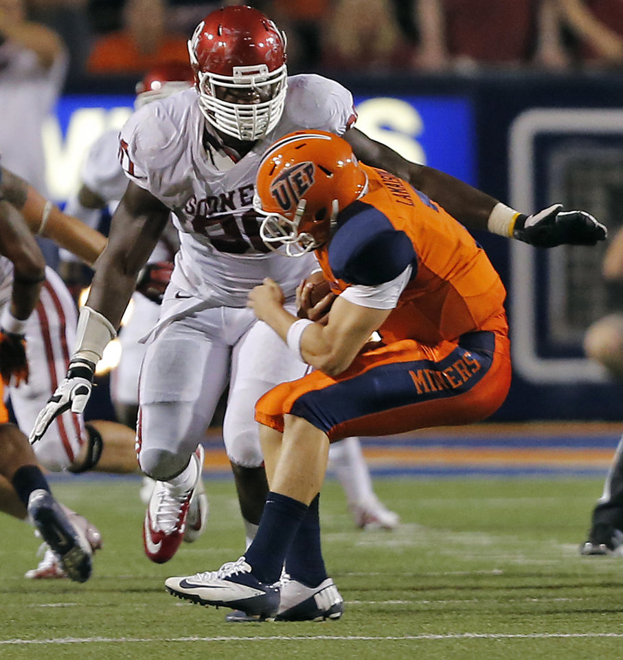 Oklahoma Sooners defensive end Chuka Ndulue (98) brings down UTEP Miners quarterback Nick Lamaison (7) during the college football game between the University of Oklahoma Sooners (OU) and the University of Texas El Paso Miners (UTEP) at Sun Bowl Stadium on Sunday, Sept. 2, 2012, in El Paso, Tex.  Photo by Chris Landsberger, The Oklahoman