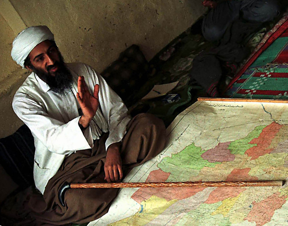 Photo - FILE - In this April 1998 file photo, exiled Saudi dissident Osama bin Laden is shown in Afghanistan. A person familiar with developments on Sunday, May 1, 2011 says bin Laden is dead and the U.S. has the body. (AP Photo, File) ORG XMIT: NYBL101