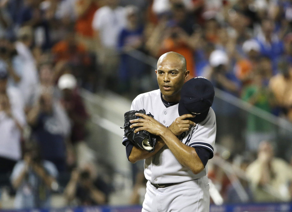 Photo - American League's Mariano Rivera, of the New York Yankees, acknowledges a standing ovation during the eighth inning of the MLB All-Star baseball game, on Tuesday, July 16, 2013, in New York.  (AP Photo/Matt Slocum)