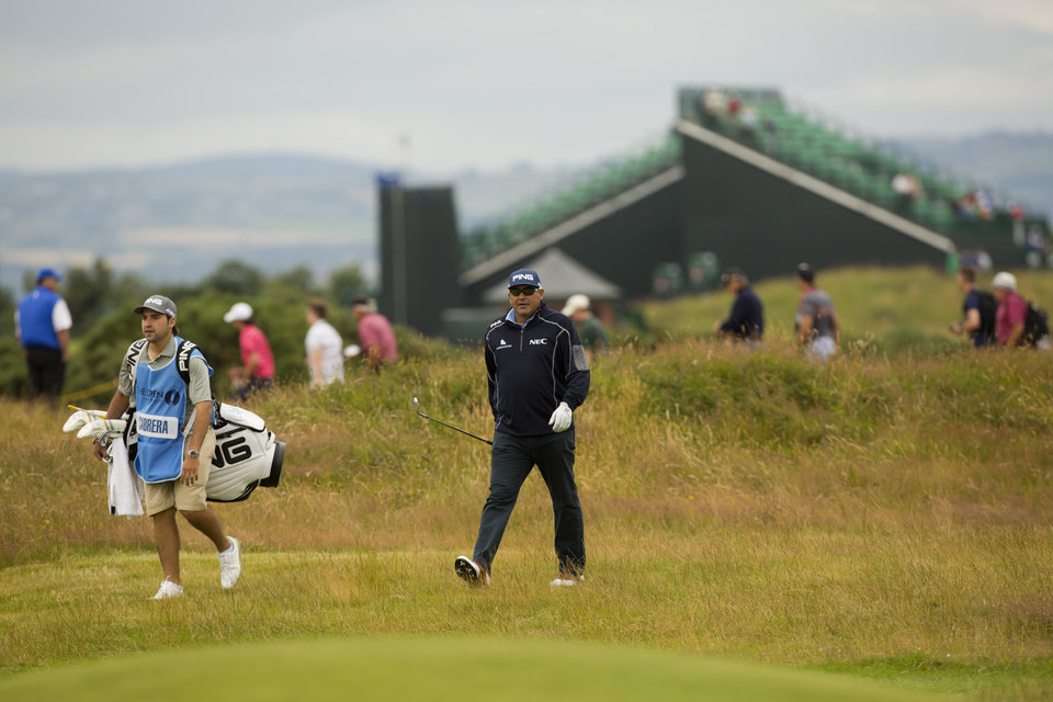 Photo - Argentina's Angel Cabrera walks down the 7th fairway during a practice round at Royal Liverpool Golf Club prior to the start of the British Open Golf Championship, in Hoylake, England, Monday, July 14, 2014. The 2014 Open Championship starts on Thursday, July 17. (AP Photo/Jon Super)