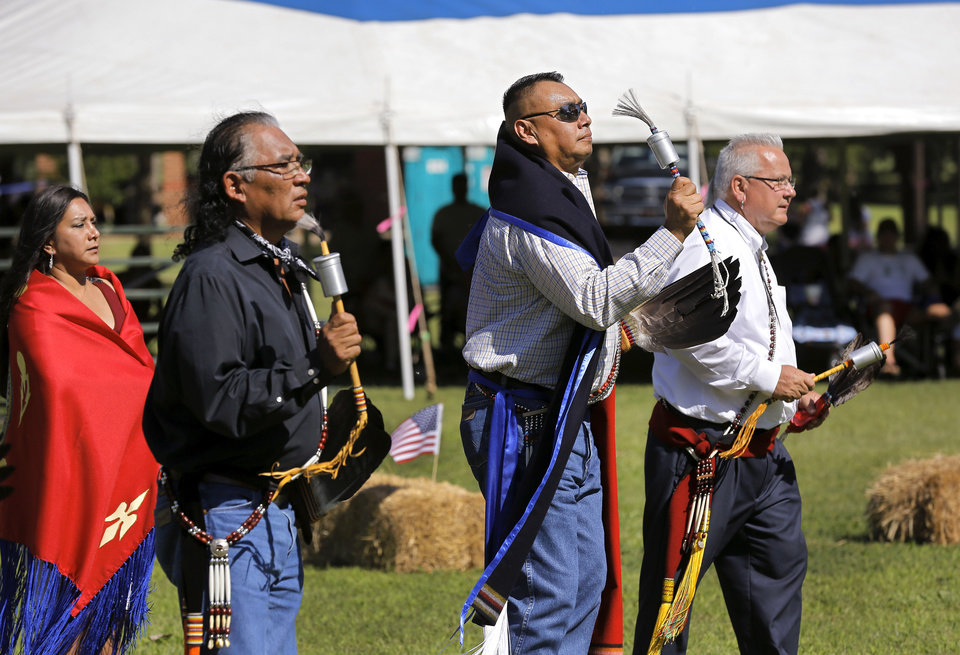 Photo -  Harold Morris, second from right, a Choctaw from Moore, joins fellow dancers in a gourd dance. Photo by Jim Beckel, The Oklahoman   Jim Beckel -