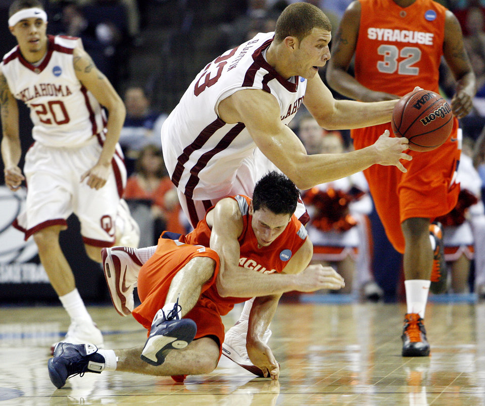 Oklahoma's Blake Griffin (23) trips over Syracuse's Rautins (1) during the second half of the NCAA Men's Basketball Regional at the FedEx Forum on Friday, March 27, 2009, in Memphis, Tenn.