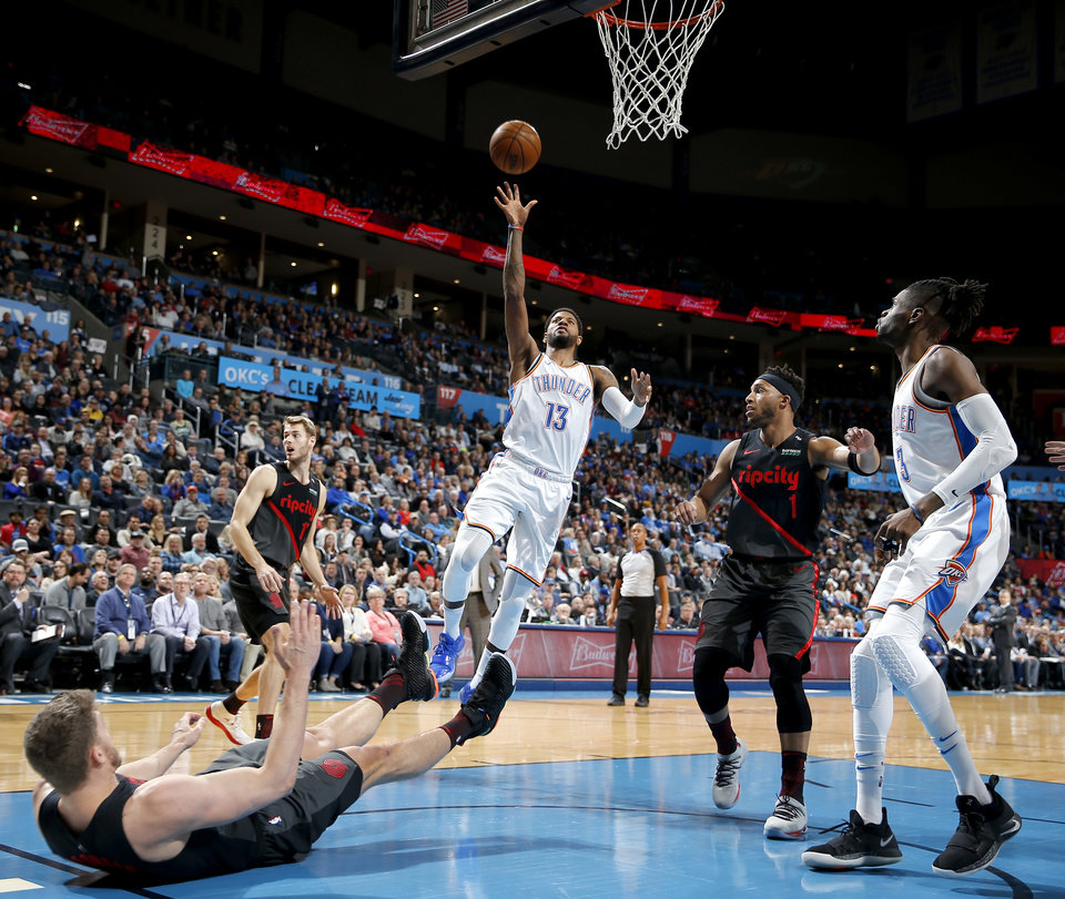 Photo - Oklahoma City's Paul George (13) goes up for a lay up during the NBA basketball game between the Oklahoma City Thunder and the Portland Trail Blazers at Chesapeake Energy Arena in Oklahoma City, Tuesday, Jan. 22, 2019. Photo by Sarah Phipps, The Oklahoman
