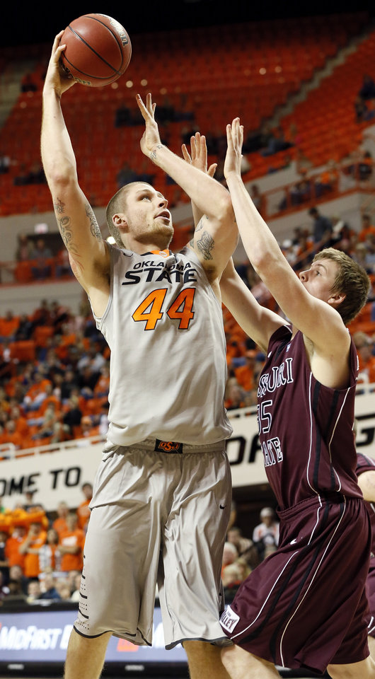 Photo - OSU's Philip Jurick (44) shoots over Bruce Marshall (35) of Missouri State during a men's college basketball between Oklahoma State University and Missouri State at Gallagher-Iba Arena in Stillwater, Okla., Saturday, Dec. 8, 2012. OSU won, 62-42. Photo by Nate Billings, The Oklahoman