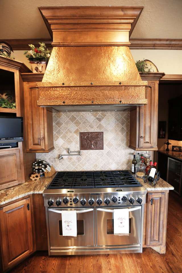 Photo - Denise Patterson's kitchen features a double oven with double cooktop.