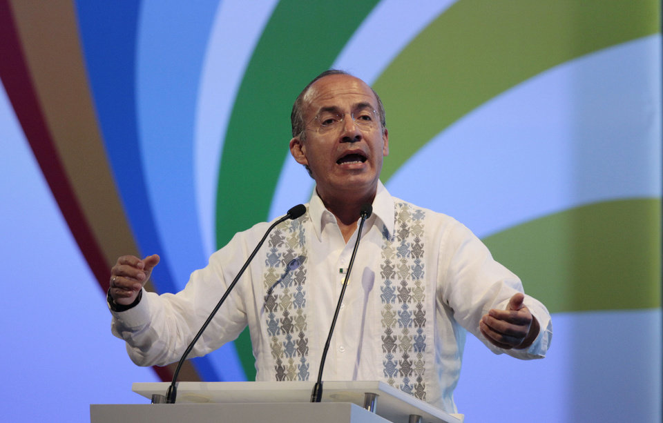 Mexico's President Felipe Calderon speaks at the 2012 CEO Summit of the Americas in Cartagena, Colombia, Friday April 13, 2012. Regional business leaders are meeting to discuss trade and investment opportunities in Latin America. The summit is being held parallel to the sixth Summit of the Americas meeting for leaders of the Western Hemisphere. (AP Photo/Fernando Llano)
