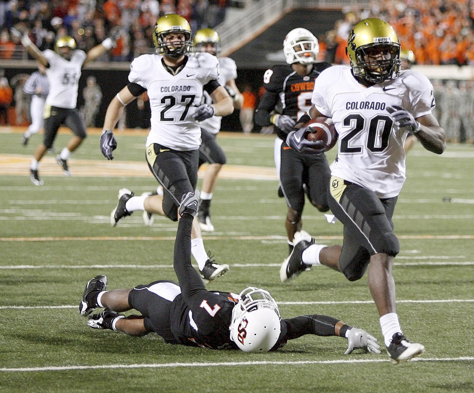 Photo - Colorado's Brian Lockridge scores a touchdown on a kick return  during the college football game between Oklahoma State University (OSU) and the University of Colorado (CU) at Boone Pickens Stadium in Stillwater, Okla., Thursday, Nov. 19, 2009. Photo by Bryan Terry, The Oklahoman