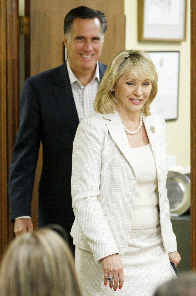 Photo - Oklahoma Gov. Mary Fallin, right, and Republican presidential candidate, former Massachusetts Gov. Mitt Romney, left, arrive at state Republican Party Headquarters in Oklahoma City, Wednesday, May 9, 2012. (AP Photo/Sue Ogrocki) ORG XMIT: OKSO104