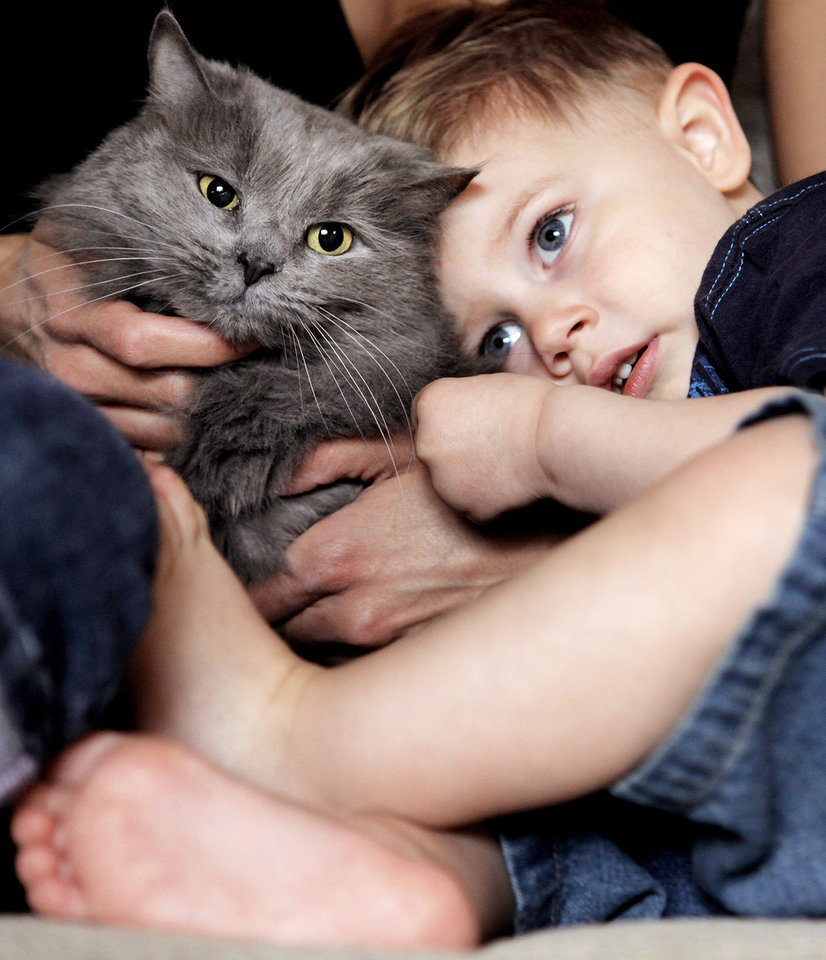Demitri Behram Farley, 2, cuddles with his cat, Penelope, in Hyattsville, Md.AP Photo