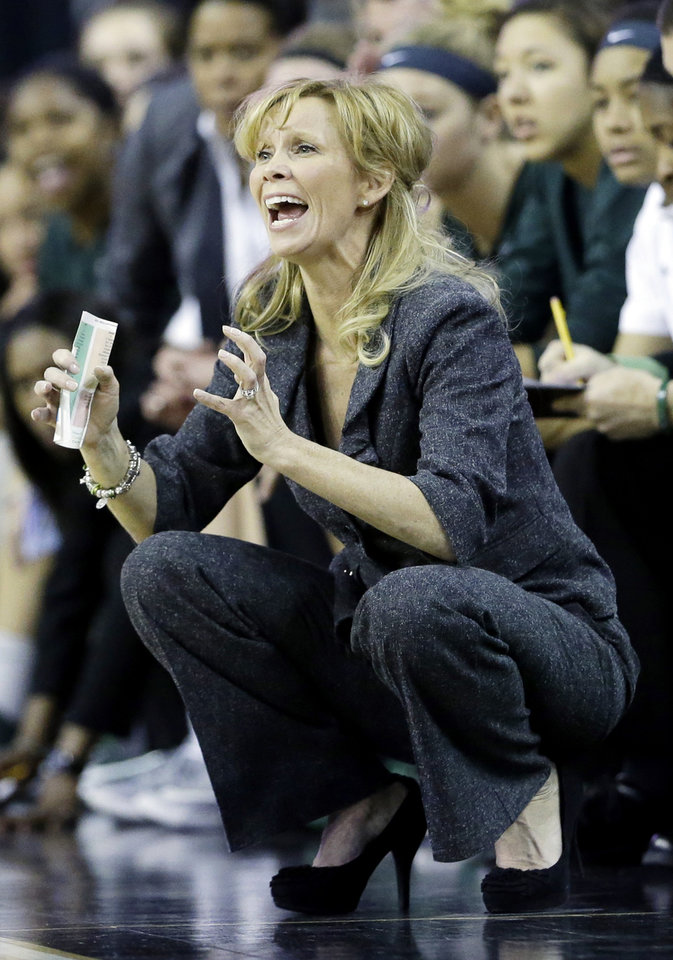 Photo - Michigan State head coach Suzy Merchant yells her team during the second half of an NCAA college basketball game against Penn State in the Big Ten Conference tournament in Hoffman Estates, Ill., on Saturday, March 9, 2013. Michigan State won 54-46. (AP Photo/Nam Y. Huh)