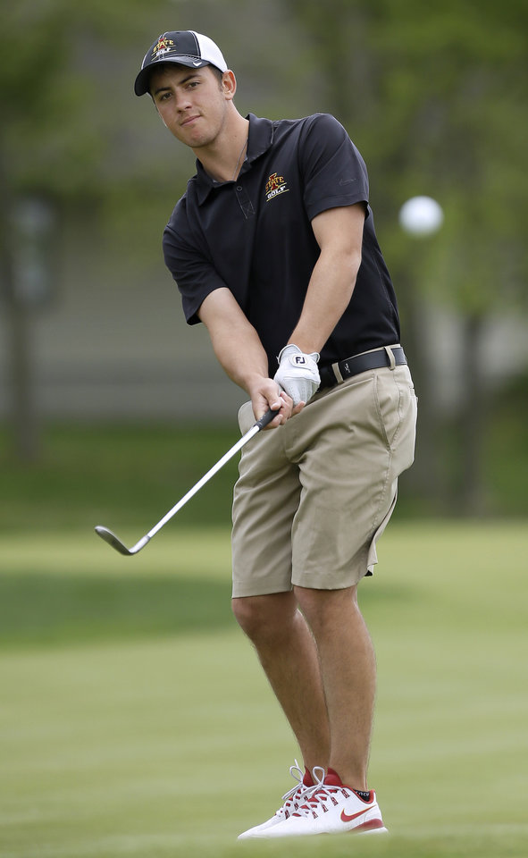 Photo - Iowa State golfer Scott Fernandez hits on to a practice green at the school's Golf Performance Center, Monday, May 19, 2014, in Ames, Iowa. Iowa State is headed to the NCAA tournament for the first time in 61 years, snapping one of the longest droughts. (AP Photo/Charlie Neibergall)