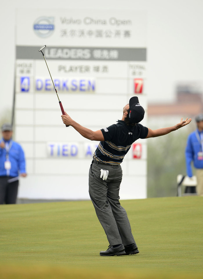 In this photo released by OneAsia, Pablo Larrazabal of Spain reacts to a missed putt on the 17th green during the second round of China Open golf tournament at Tianjin Binhai Lake Golf Club in Tianjin, China on Friday, May 3, 2013. (AP Photo/OneAsia, Paul Lakatos) NO LICENSING