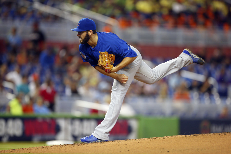 Photo - Chicago Cubs starter Jake Arrieta pitches to the Miami Marlins during the first inning of a baseball game in Miami, Wednesday, June 18, 2014.  (AP Photo/J Pat Carter)