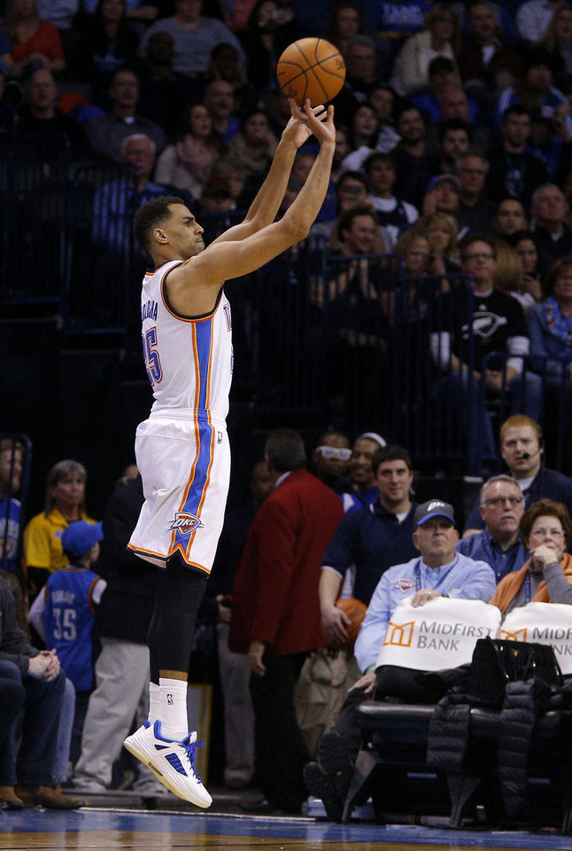 Photo - Oklahoma City's Thabo Sefolosha (25) shoots a three-point basket during an NBA basketball game between the Oklahoma CIty Thunder and the Minnesota Timberwolves at Chesapeake Energy Arena in Oklahoma City, Wednesday, Feb. 5, 2014. Oklahoma City won 106-97. PHOTO BY BRYAN TERRY, The Oklahoman