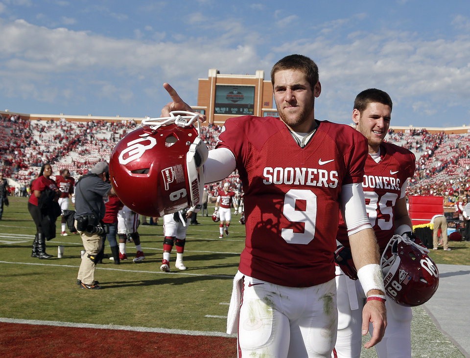 Oklahoma's Trevor Knight (9) points to the fans after the 48-10 win over Iowa State during the college football game between the University of Oklahoma Sooners (OU) and the Iowa State University Cyclones (ISU) at Gaylord Family-Oklahoma Memorial Stadium in Norman, Okla. on Saturday, Nov. 16, 2013. Photo by Chris Landsberger, The Oklahoman