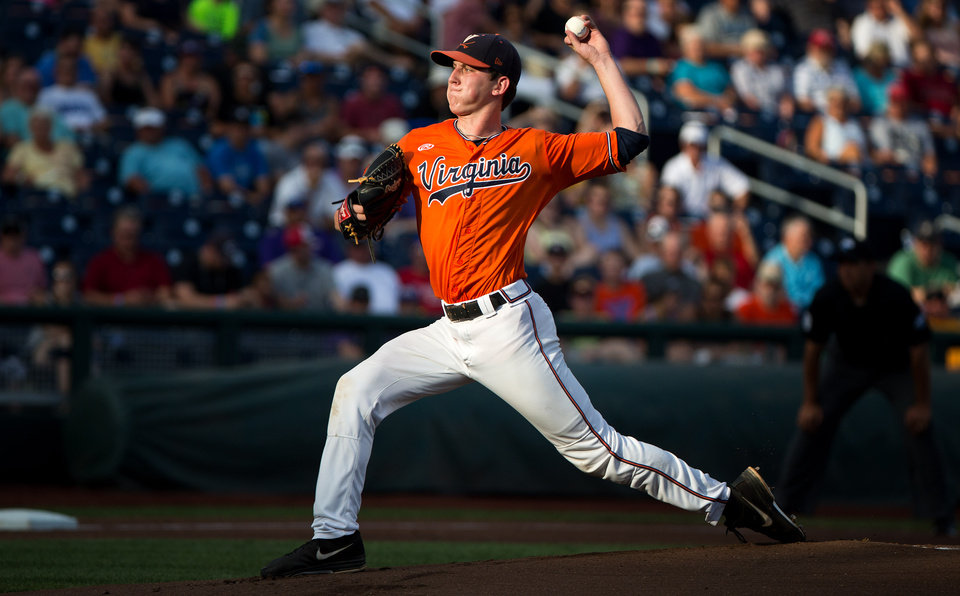 Photo - Virginia starting pitcher Brandon Waddell throws against TCU in the top of the first inning of game 8 during the College World Series at TD Ameritrade Park in Omaha, Neb., Tuesday, June 17, 2014. (AP Photo/The Omaha World-Herald, Brendan Sullivan)