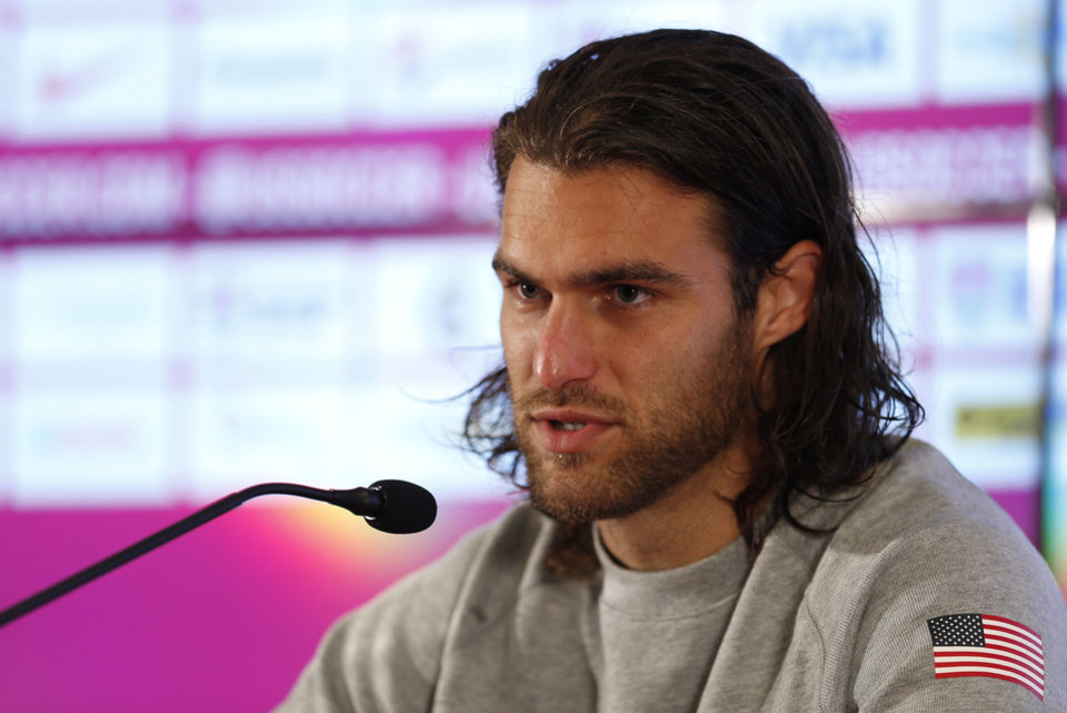 Photo - United States' Graham Zusi talks during a press conference following a training session in Sao Paulo, Brazil, Tuesday, June 17, 2014.  The United States will play against Portugal in group G of the 2014 soccer World Cup on June 22. (AP Photo/Julio Cortez)
