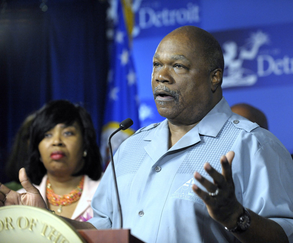 Photo - The Rev. Dr. Wendell Anthony, president of the Detroit Branch NAACP, addresses the media during a news conference on Thursday, Aug. 7, 2014 in Detroit.  Detroit Mayor Mike Duggan announced the city will offer affordable payment plans to many delinquent customers. Detroit shut off water service to around 17,000 to 18,000 residential customers, about 10 percent of the roughly 170,000 total. About 60 percent to 70 percent have been restored, and officials said restorations continue. Shutoffs have been halted until Aug. 25. (AP Photo/Detroit News, Todd McInturf)  DETROIT FREE PRESS OUT; HUFFINGTON POST OUT
