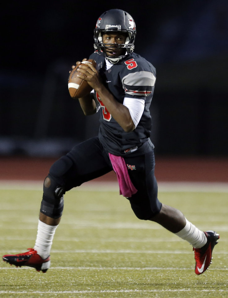 Westmoore\'s Jhames West looks to make a pass during the high school football game between Moore and Putnam City at Westmoore High School, Thursday, Oct. 4, 2012. Photo by Sarah Phipps, The Oklahoman