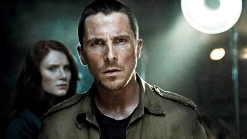 In this film publicity image released by Warner Bros., Bryce Dallas Howard, left, and Christian Bale are shown in a scene from,