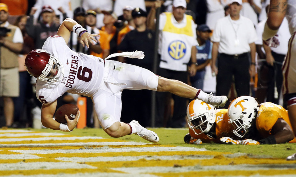Photo - Oklahoma's Baker Mayfield (6) rushes for a touchdown in overtime during the college football game between the Oklahoma Sooners (OU) and the Tennessee Volunteers at Neyland Stadium in Knoxville, Tennessee, Saturday, Sept. 12, 2015. OU won 31-24 in double overtime. Photo by Nate Billings, The Oklahoman