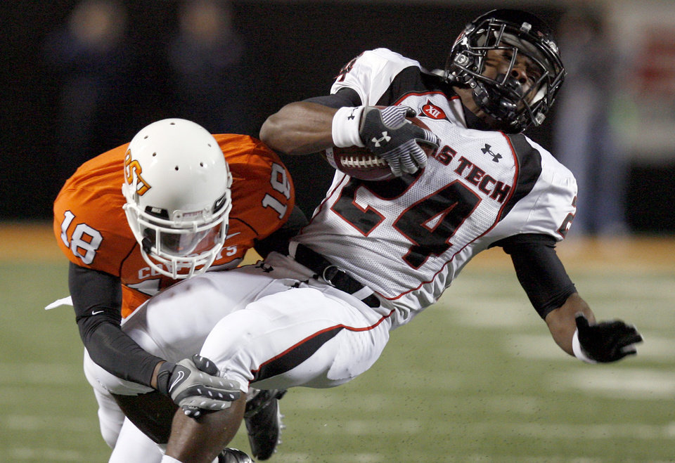 Photo - OSU's Andrae May  (18) tackles Texas Tech's Eric Stephens (24)  during the second half of the college football game between Oklahoma State University (OSU) and Texas Tech University at Boone Pickens Stadium in Stillwater, Okla. Saturday, Nov. 14, 2009. Photo by Sarah Phipps, The Oklahoman