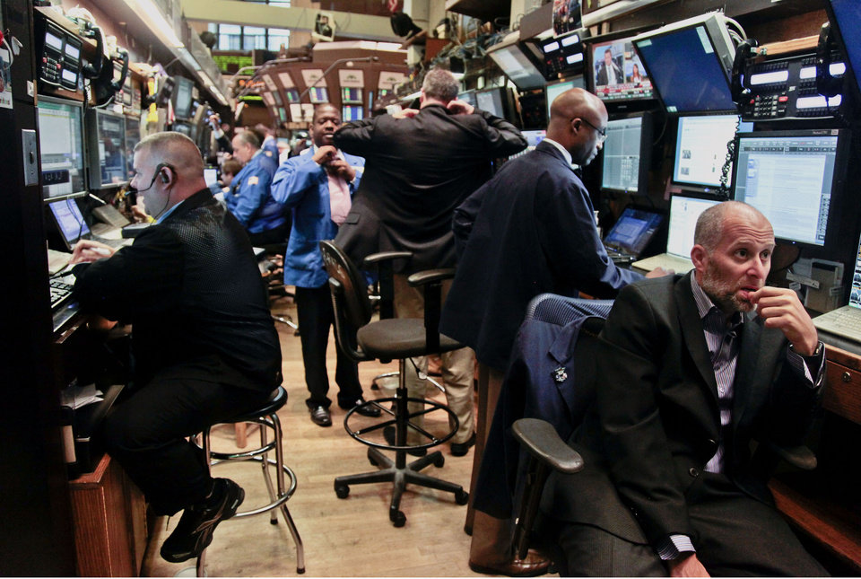 Photo -   FILE- In this Tuesday, July 10, 2012, file photo, traders prepare for the start of early trading at the New York Stock Exchange. (AP Photo/Bebeto Matthews, File)